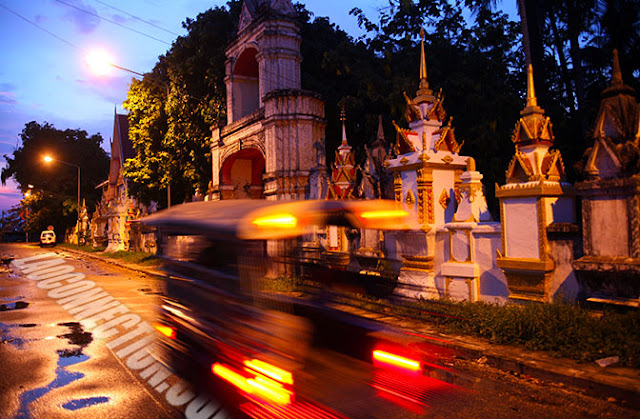 Tuktuk passes Wat Saiynaphum in Savannakhet