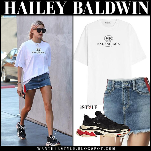 Hailey Baldwin in white logo tee, denim mini skirt and black sneakers balenciaga model street style january 11