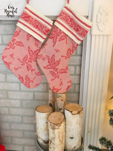 red white toile Christmasstocking mantel birch logs