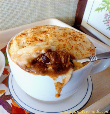 Chili Beef Pot Pie, a potato crusted pot pie full of beef, beans and corn cooked chili style. A hearty winter dish | Recipe developed by www.BakingInATornado.com | #dinner #beef