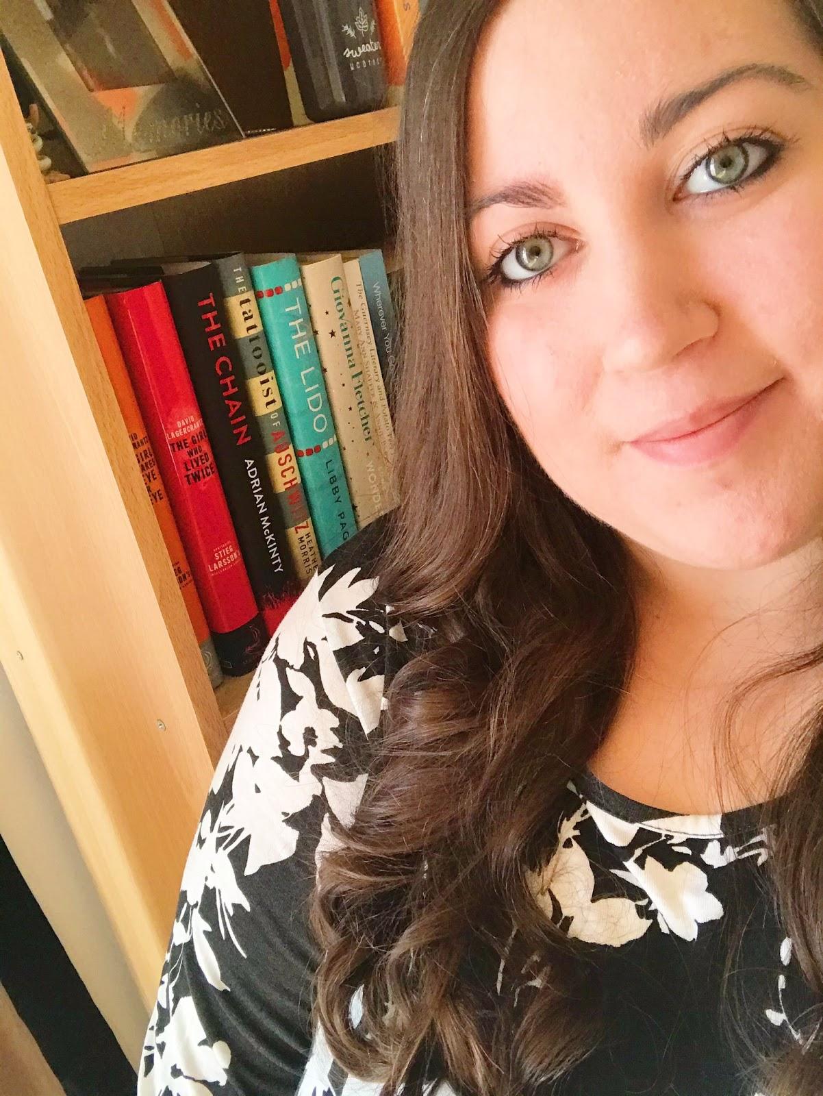 Selfie focusing on hair in front of bookshelf