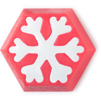 A bright neon pink hexagonal shaped soap with a white snowflake design in the middle on a bright background