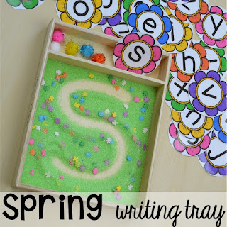 Spring themed writing tray plus Plant Needs and Life Cycle Posters FREEBIE. Prefect for preschool, pre-k, and kindergarten.