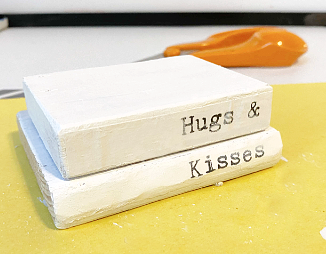 hugs and kisses on the book stacks