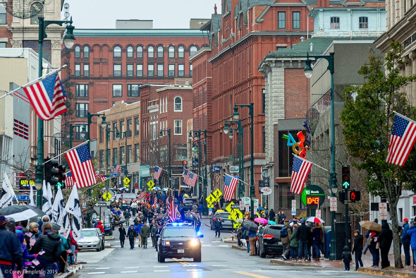 Portland, Maine USA November 2019 photo by Corey Templeton. Portland's annual Veterans Day parade making its way down Congress Street towards City Hall.
