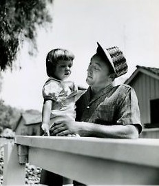 Picture of Trini Mitchum with her father when she was child