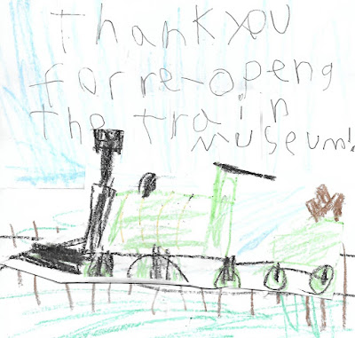 """Child's drawing of a steam locomotive on tracks. Text reads """"Thank you for reopening the train museum"""""""