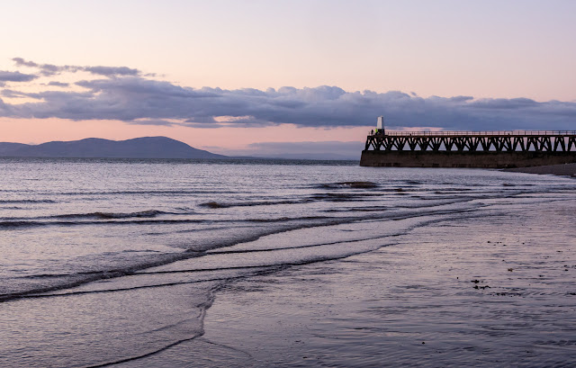 Photo of Maryport's south pier at sunset