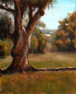 Oil painting of a mature River Red Gum beside a steel track running horizontally across the picture.  The background contains a number of eucalypts and distant buildings.