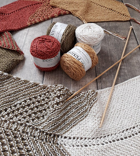 Woolen yarn and fabrics