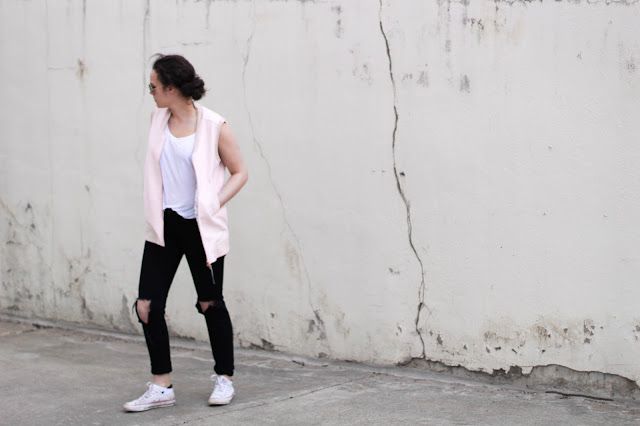 Pink Lululemon Vest and ripped jeans