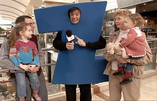 Stephen Colbert as the letter Z interviews a family with two children. Sesame Street All Star Alphabet