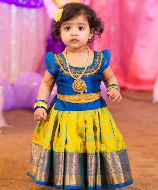 Cute Kid in Lakshmi Pendant and Vaddanam