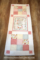 quilted table runner on wood background