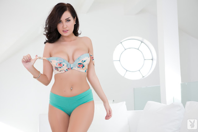 Ann Denise removing bra standing sexy hot pose