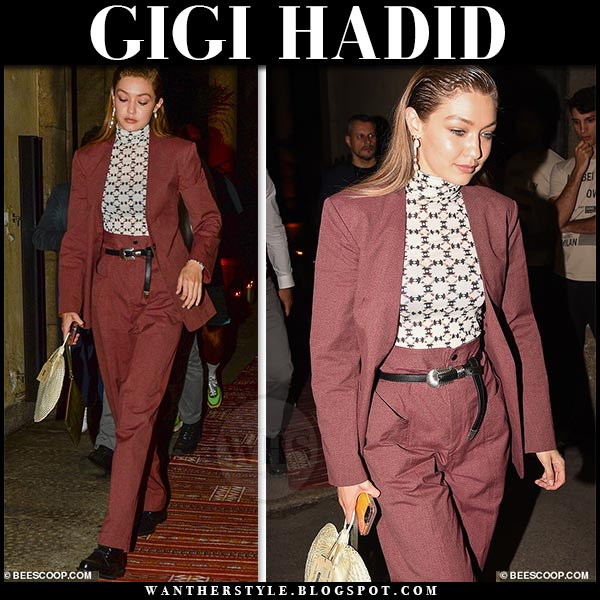 Gigi Hadid in burgundy blazer, printed top and burgundy paper isabel marant bag trousers. Celebrity street style june 15