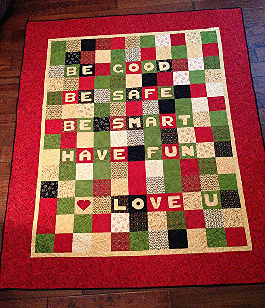 Out the Door Quilt designed by Cindy Sharp of Tops to Treasures for Moda Fabrics Studio, Quilted in Vicki Malaski's Dove Flowers