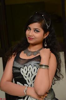 Shrisha Dasari in Sleeveless Short Black Dress At Follow Follow U Audio Launch 070.JPG