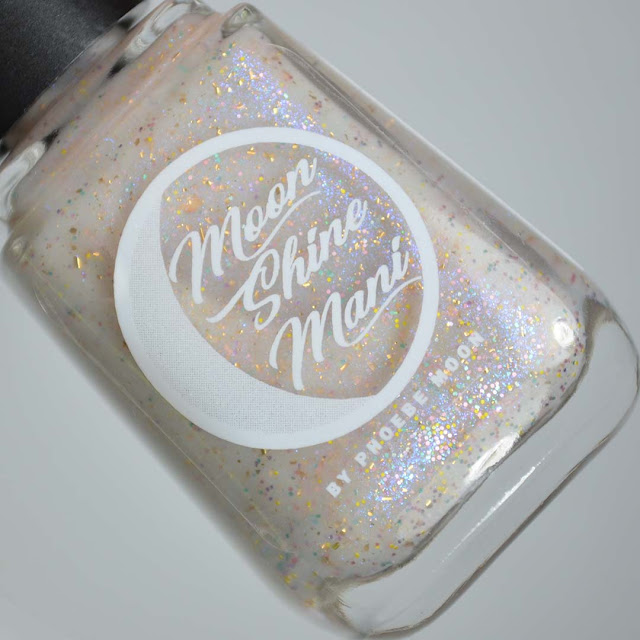 off white nail polish with sparkles and color shifting flakies in a bottle