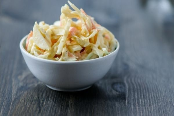 Small white bowl of coleslaw