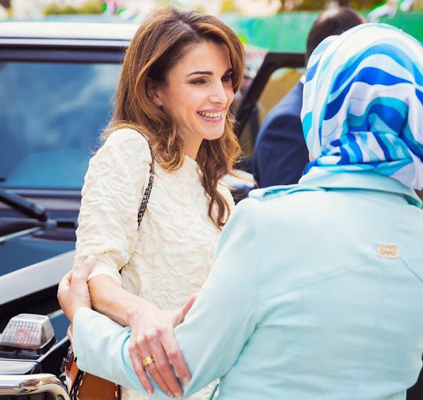 Queen Rania of Jordan visited the Safout Secondary School for Girls in connection with 70th anniversary of Jordan's Independence Day and the 100th anniversary of the Great Arab Revolt. Queen Rania Style, Fendi dress, a bag