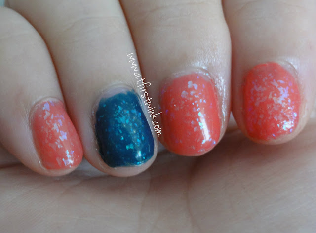 dark blue and pink flakies nails