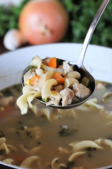 Ladle of Quick Turkey Noodle Soup Image