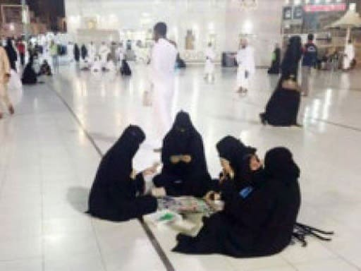 FOUR WOMEN SPOTTED PLAYING CARDS IN MAKKAH