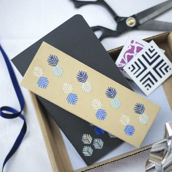 stitched design on small box and notebook; paper cut gift tags