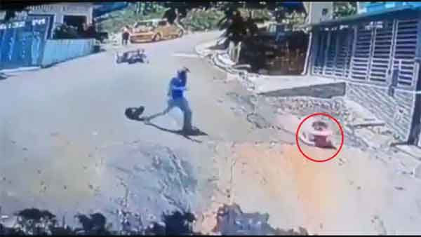 News, World, Colombia, Video, Viral, Baby, Bike Traveler, Social Media, Man jumps off bike to save toddler rolling downhill in stroller, Watch