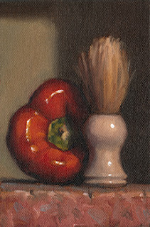 Still life oil painting of a shaving brush beside a red pepper.