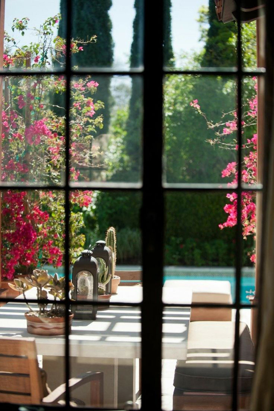 View to the garden. Photo by Suzi Q via Style Me Pretty.