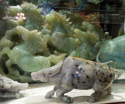 nephrite carvings and a buffalo