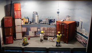 Civil Diorama; Civilian Toy Figures; Container Port Diorama; Container Port Facilities; Customs Diorama; Dockside Diorama; Drugs Check; Freight Handling; Jetty Diorama; Modern Port Facilities; Museum Display; Museum Exhibit; National Maritime Museum; New Zealand; NMM Diorama; NZ NMM; Search for Contraband; Small Scale World; smallscaleworld.blogspot.com; Sniffer Dog; Victorian Diorama; Victorian New Zealand; Victorian Port Scene; Warf Diorama;