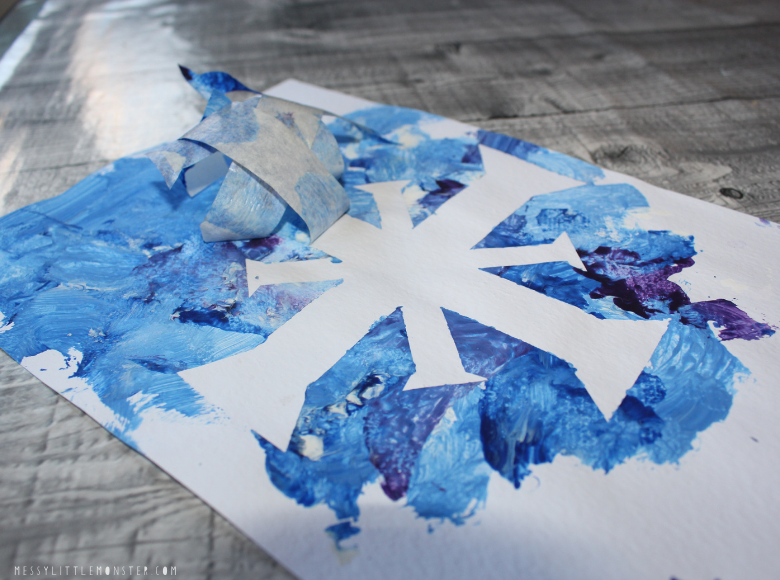 tape resist art snowflake craft for toddlers and preschoolers.