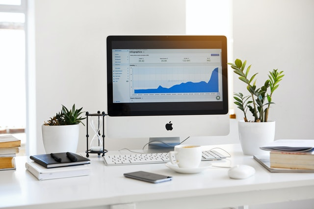 A White Monitor Showing Grow Of Online Business