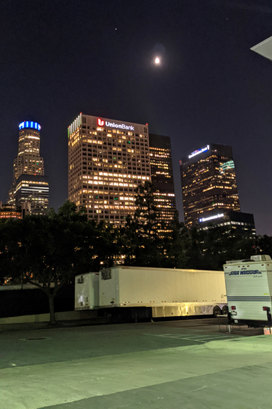 Jupiter, the Moon and Saturn loom high above downtown Los Angeles...on October 14, 2021.