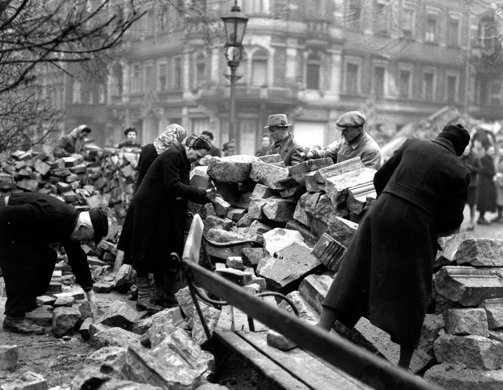 Volunteers clear rubble on a Sunday morning. 1946.