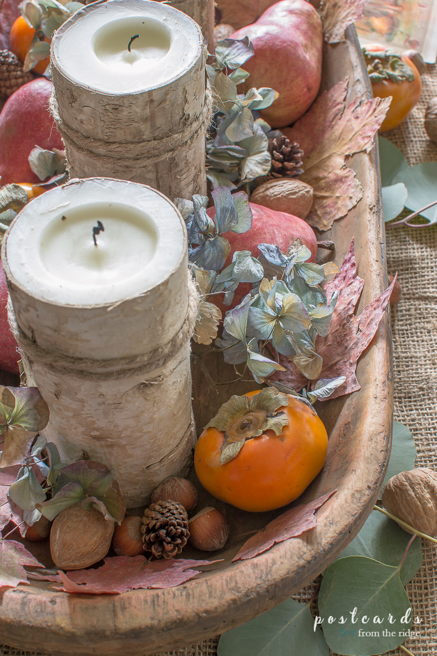 birch wrapped candles with persimmons and nuts
