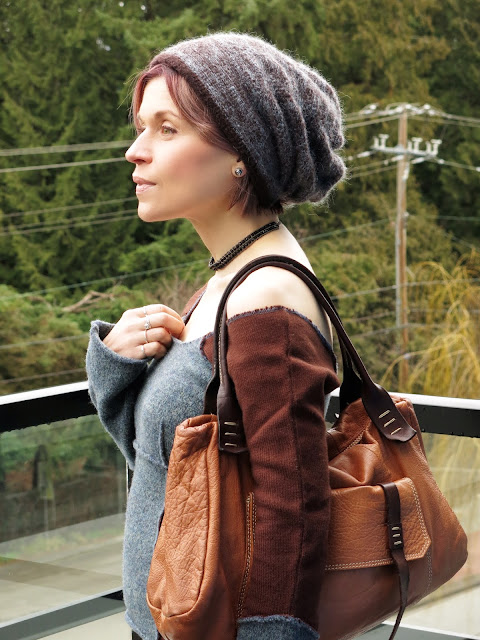 off-the-shoulder sweater, woolen beanie, cognac satchel