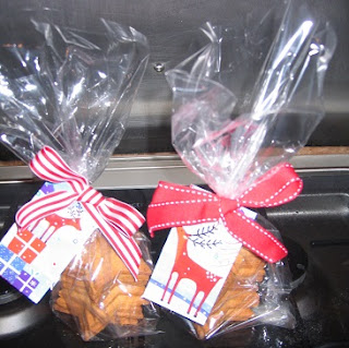 Picture of two bags of Christmas biscuits, with decorative labels and coloured ribbons as Christmas presents
