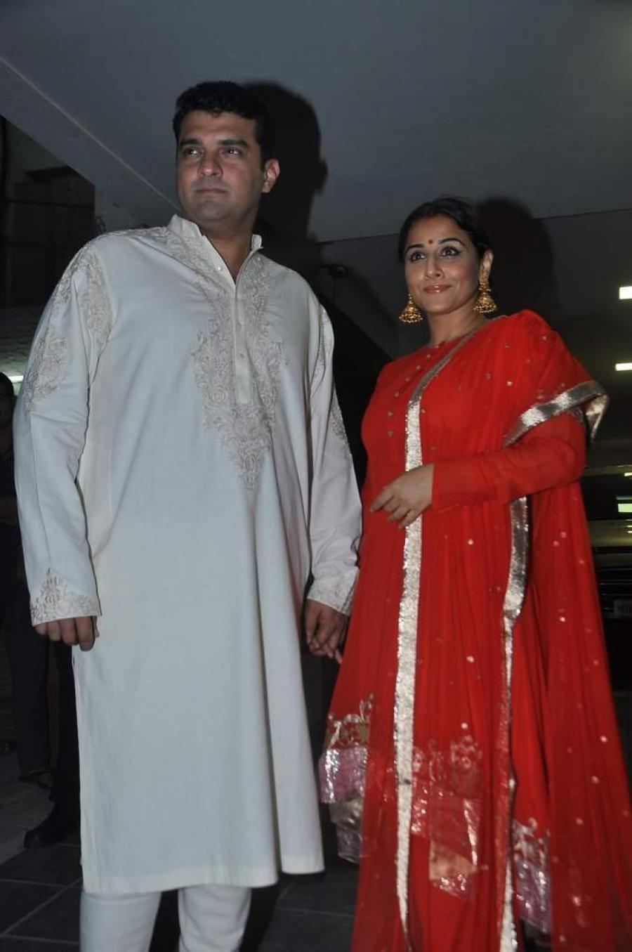 Vidya Balan With Husband Photos In Red Dress