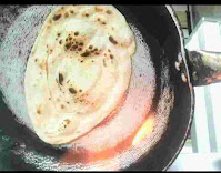 Butter Naan over gas flame