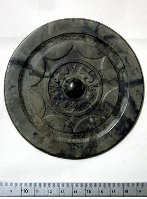 Ancient Chinese bronze mirror unearthed whole in Fukuoka dig