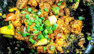 Chilli chicken topped with chopped spring onions