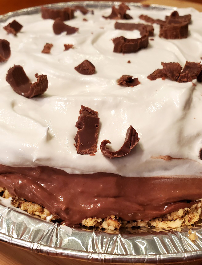 a no bake pie with a chocolate mousse filling and pretzel crust