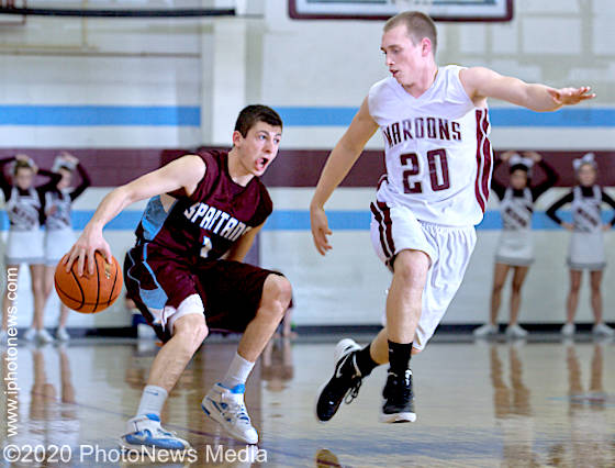 Aaron Woller dribbles the ball behind his back in SJO Class 2A semifinal