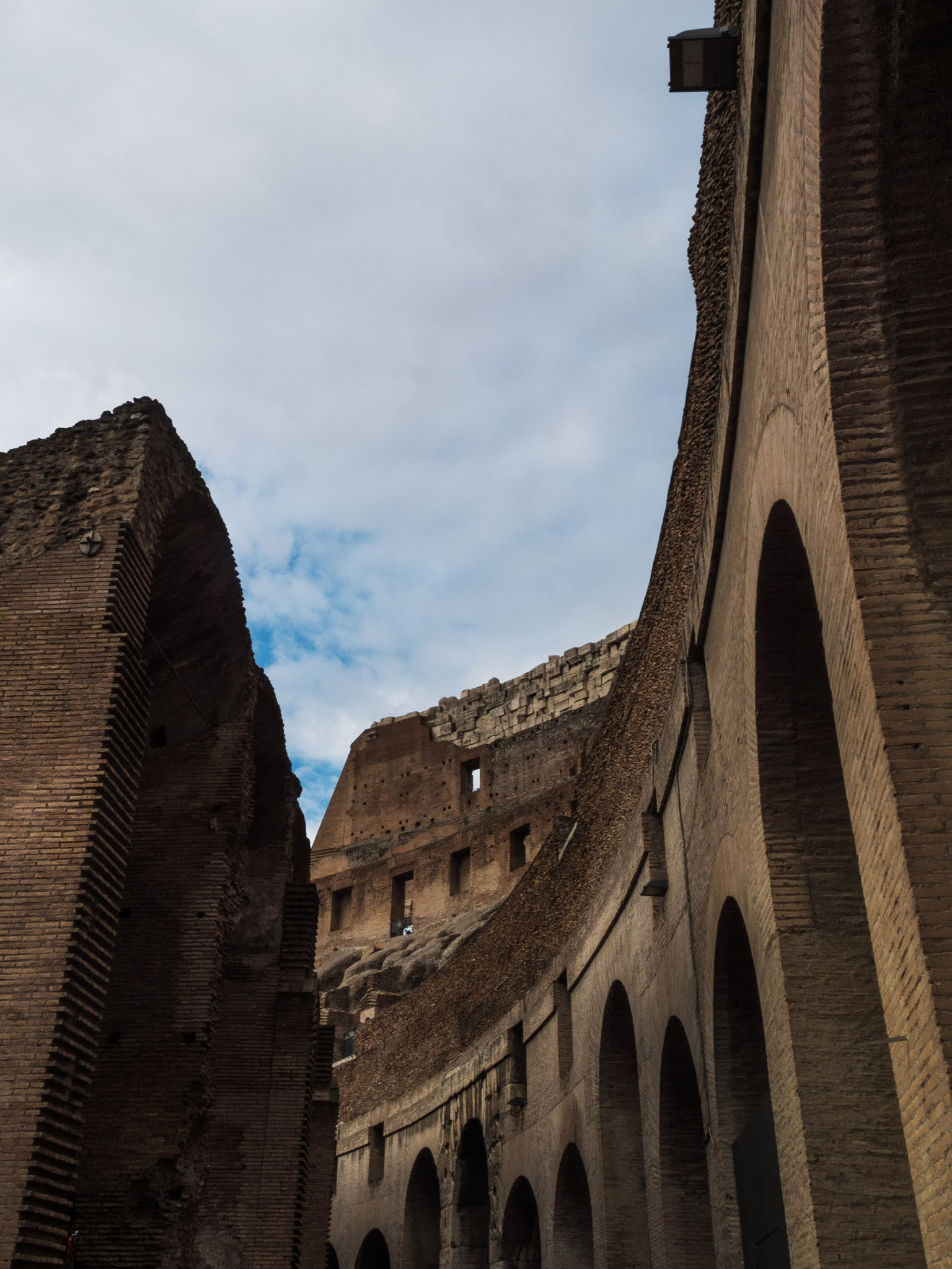 Looking up at the arches inside the Colosseum.