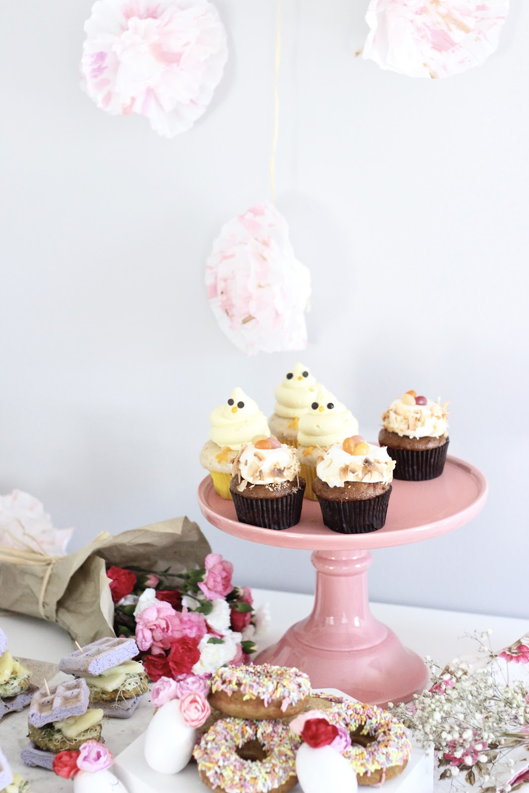 Pastels and Pastries- Easy Easter Entertaining / Easter Table Kelly's Bake Shoppe Sprinkle cookies & donuts/ The Burger Pawty Dream Burger / The Fix + Co plant based Platter