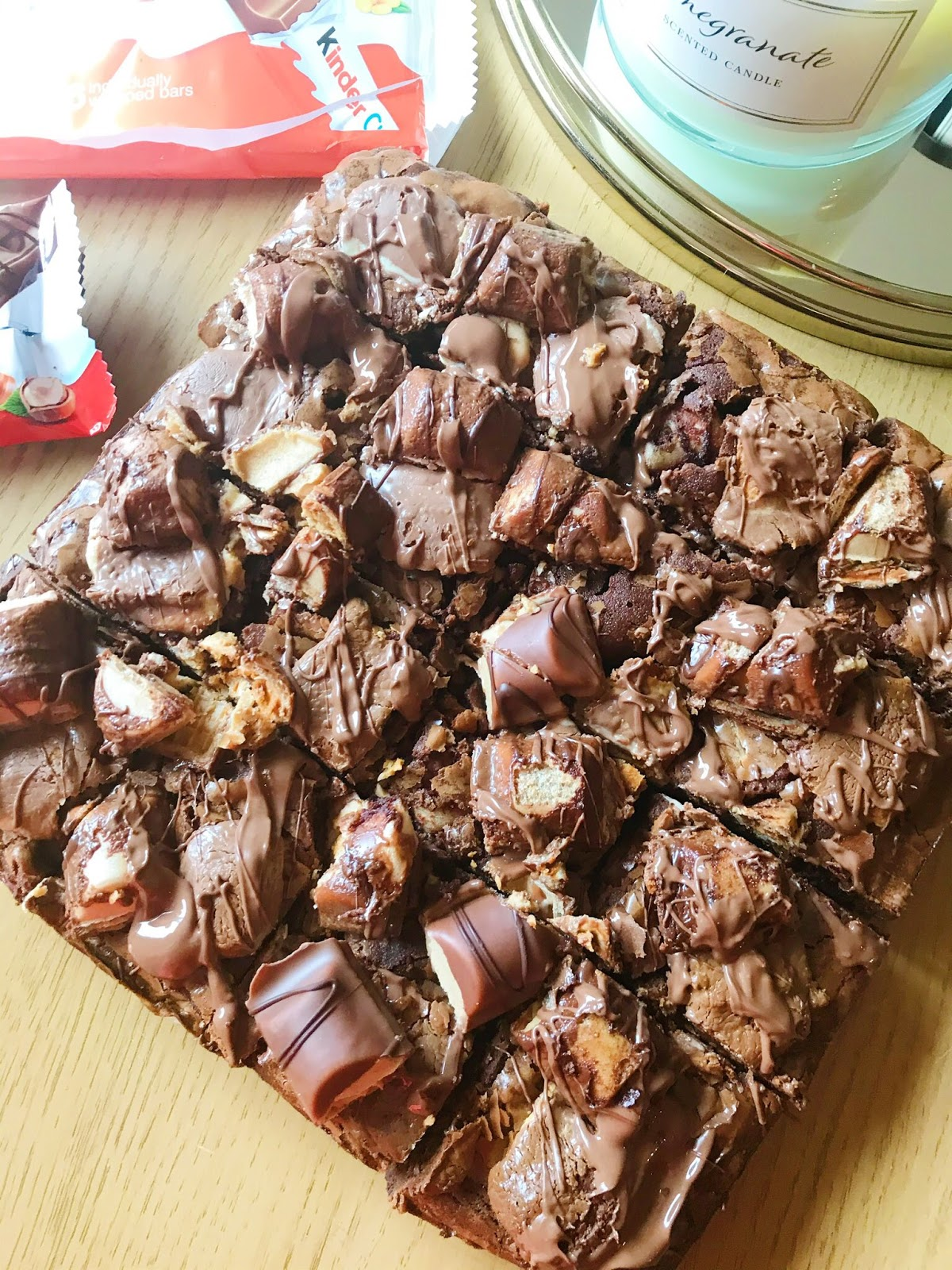 Kinder Buenos brownies on coffee table with Kinder bars next to it
